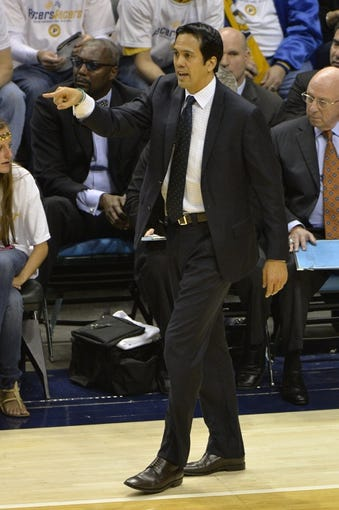 May 26, 2013; Indianapolis, IN, USA; Miami Heat head coach Erik Spoelstra calls out instructions during the second quarter against the Indiana Pacers in game three of the Eastern Conference finals of the 2013 NBA Playoffs at Bankers Life Fieldhouse. Miami defeated Indiana 114-96.  Mandatory Credit: Jamie Rhodes-USA TODAY Sports
