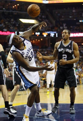 May 27, 2013; Memphis, TN, USA; Memphis Grizzlies power forward Zach Randolph (50) battles for a loose ball with San Antonio Spurs small forward Kawhi Leonard (2) in the second half of game four of the Western Conference finals of the 2013 NBA Playoffs at FedEx Forum.  The Spurs won 93-86.  Mandatory Credit: Spruce Derden-USA TODAY Sports