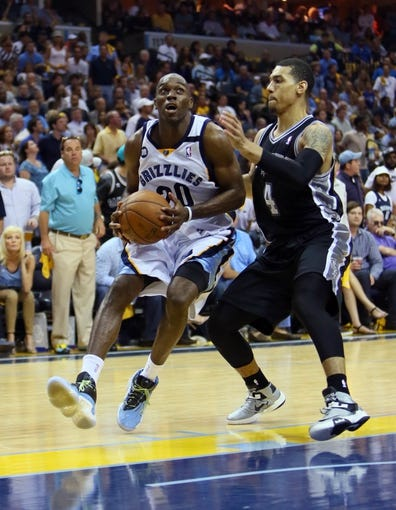 May 27, 2013; Memphis, TN, USA; Memphis Grizzlies small forward Quincy Pondexter (20) drives against San Antonio Spurs shooting guard Danny Green (4) in the second half of game four of the Western Conference finals of the 2013 NBA Playoffs at FedEx Forum.  The Spurs won 93-86.  Mandatory Credit: Spruce Derden-USA TODAY Sports