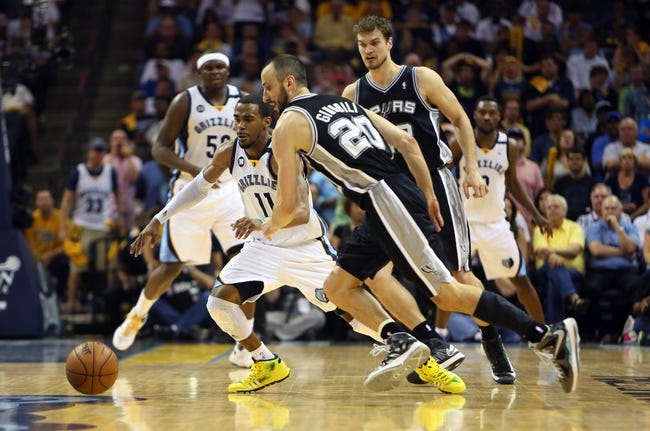 May 27, 2013; Memphis, TN, USA; San Antonio Spurs shooting guard Manu Ginobili (20) chases after a loose ball with Memphis Grizzlies point guard Mike Conley (11) in the second half of game four of the Western Conference finals of the 2013 NBA Playoffs at FedEx Forum.  The Spurs won 93-86.  Mandatory Credit: Spruce Derden-USA TODAY Sports