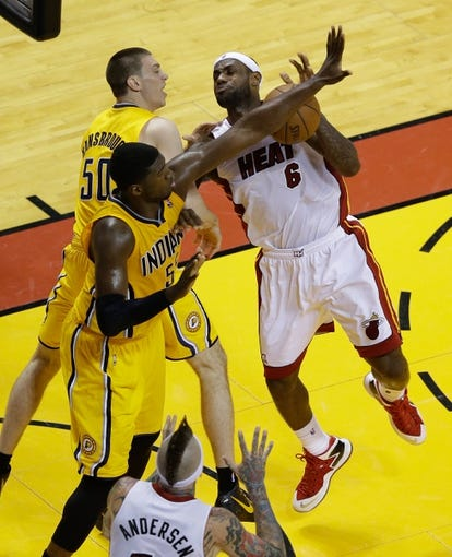 Jun 3, 2013; Miami, FL, USA; Miami Heat small forward LeBron James (6) is fouled Indiana Pacers power forward Tyler Hansbrough (50) as center Roy Hibbert (55) also defends during the second quarter of game 7 of the 2013 NBA Eastern Conference Finals at American Airlines Arena. Mandatory Credit: Robert Mayer-USA TODAY Sports