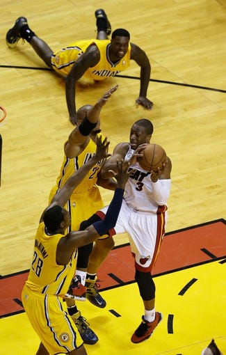 Jun 3, 2013; Miami, FL, USA;  Miami Heat shooting guard Dwyane Wade (3) is defended by Indiana Pacers power forward David West (21) and power forward David West (21) as shooting guard Lance Stephenson (1) looks on during the second quarter of game 7 of the 2013 NBA Eastern Conference Finals at American Airlines Arena. Mandatory Credit: Robert Mayer-USA TODAY Sports