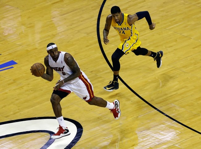Jun 3, 2013; Miami, FL, USA;  Miami Heat small forward LeBron James (6) dribbles the ball past Indiana Pacers small forward Paul George (24) during the first quarter of game 7 of the 2013 NBA Eastern Conference Finals at American Airlines Arena. Mandatory Credit: Robert Mayer-USA TODAY Sports