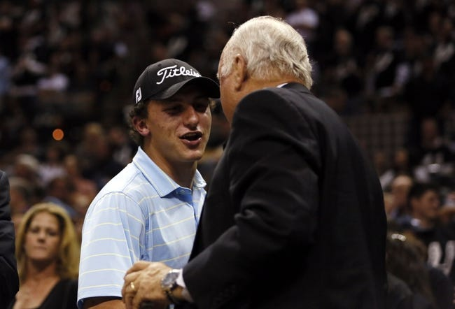 Jun 11, 2013; San Antonio, TX, USA;  Texas A&M Aggies quarterback Johnny Manziel (left) in attendance during game three of the 2013 NBA Finals between the Miami Heat and the San Antonio Spurs at the AT&T Center. San Antonio Spurs won 113-77.  Mandatory Credit: Soobum Im-USA TODAY Sports