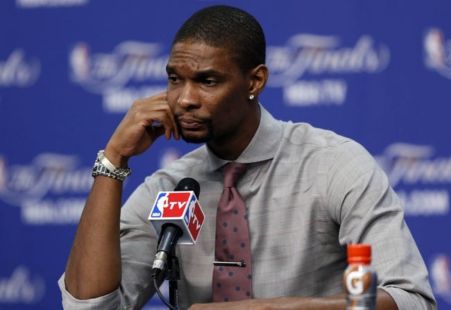 Jun 11, 2013; San Antonio, TX, USA; Miami Heat center Chris Bosh addresses the media after game three of the 2013 NBA Finals against the San Antonio Spurs at the AT&T Center. San Antonio Spurs won 113-77.  Mandatory Credit: Soobum Im-USA TODAY Sports