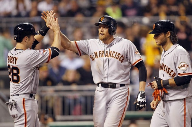 Jun 13, 2013; Pittsburgh, PA, USA; San Francisco Giants right fielder Hunter Pence (center) is greeted at home plate by catcher Buster Posey (28) and shortstop Brandon Crawford (right) after Pence hit a three run home run against the Pittsburgh Pirates during the sixth inning at PNC Park. Mandatory Credit: Charles LeClaire-USA TODAY Sports