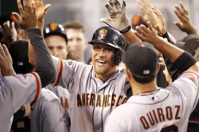 Jun 13, 2013; Pittsburgh, PA, USA; San Francisco Giants right fielder Hunter Pence (center) is congratulated by teammates in the dugout after hitting a three run home run against the Pittsburgh Pirates during the sixth inning at PNC Park. Mandatory Credit: Charles LeClaire-USA TODAY Sports