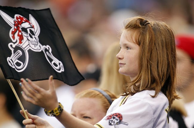 Jun 13, 2013; Pittsburgh, PA, USA; Pittsburgh Pirates fan Taylor Briney  cheers for the Pirates during the fourth inning against the San Francisco Giants at PNC Park. Mandatory Credit: Charles LeClaire-USA TODAY Sports