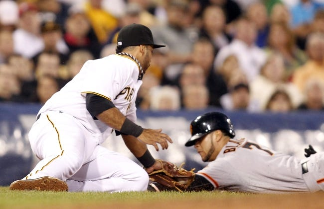 Jun 13, 2013; Pittsburgh, PA, USA; Pittsburgh Pirates third baseman Pedro Alvarez (left) is late with a tag on San Francisco Giants left fielder Gregor Blanco (right) during the sixth inning at PNC Park. Mandatory Credit: Charles LeClaire-USA TODAY Sports