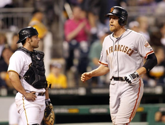 Jun 13, 2013; Pittsburgh, PA, USA; San Francisco Giants right fielder Hunter Pence (8) crosses home plate after hitting a three run home run as Pittsburgh Pirates catcher Michael McKenry (left) reacts during the sixth inning at PNC Park. The San Francisco Giants won 10-0. Mandatory Credit: Charles LeClaire-USA TODAY Sports
