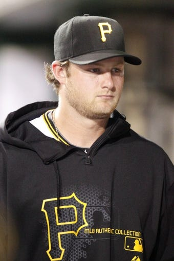 Jun 13, 2013; Pittsburgh, PA, USA; Pittsburgh Pirates starting pitcher Gerrit Cole (45) in the dugout against the San Francisco Giants during the eighth inning at PNC Park. The San Francisco Giants won 10-0. Mandatory Credit: Charles LeClaire-USA TODAY Sports