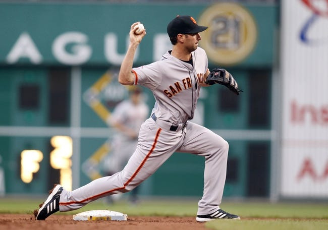 Jun 13, 2013; Pittsburgh, PA, USA; San Francisco Giants second baseman Nick Noonan (21) throws to first to complete a double play against the Pittsburgh Pirates during the second inning at PNC Park. The San Francisco Giants won 10-0. Mandatory Credit: Charles LeClaire-USA TODAY Sports