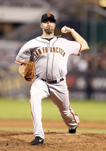 Jun 13, 2013; Pittsburgh, PA, USA; San Francisco Giants relief pitcher Jeremy Affeldt (41) pitches against the Pittsburgh Pirates during the ninth inning at PNC Park. The San Francisco Giants won 10-0. Mandatory Credit: Charles LeClaire-USA TODAY Sports