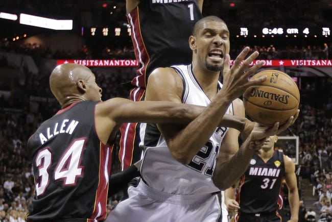 Jun 13, 2013; San Antonio, TX, USA;  San Antonio Spurs power forward Tim Duncan (21)is fouled by Miami Heat shooting guard Ray Allen (34) during the second half of game four in the 2013 NBA Finals at the AT&T Center. Mandatory Credit: Eric Gay-AP/Pool Photo-USA TODAY Sports