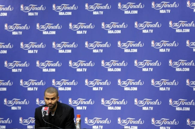 Jun 13, 2013; San Antonio, TX, USA; San Antonio Spurs point guard Tony Parker (9) speaks at a postgame press conference following game four against the Miami Heat in the 2013 NBA Finals at the AT&T Center. The Heat defeated the Spurs 109-93. Mandatory Credit: Soobum Im-USA TODAY Sports