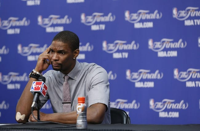 Jun 13, 2013; San Antonio, TX, USA; Miami Heat center Chris Bosh speaks at a postgame press conference following game four against the San Antonio Spurs in the 2013 NBA Finals at the AT&T Center. The Heat defeated the Spurs 109-93. Mandatory Credit: Soobum Im-USA TODAY Sports