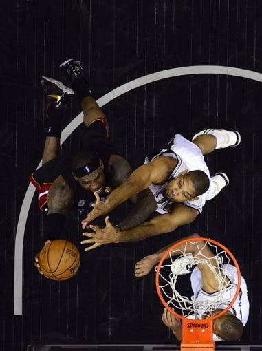 Jun 13, 2013; San Antonio, TX, USA; Miami Heat small forward LeBron James (6) drives to the basket against San Antonio Spurs power forward Tim Duncan (21) during game four in the 2013 NBA Finals at the AT&T Center. Mandatory Credit: Larry W. Smith/Pool Photo-USA TODAY Sports