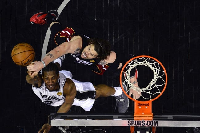 Jun 13, 2013; San Antonio, TX, USA; San Antonio Spurs small forward Kawhi Leonard (2) shoots against Miami Heat shooting guard Mike Miller (13) during game four in the 2013 NBA Finals at the AT&T Center. Mandatory Credit: Larry W. Smith/Pool Photo-USA TODAY Sports