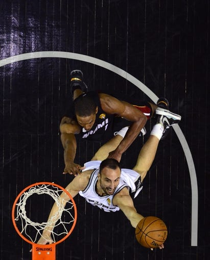 Jun 13, 2013; San Antonio, TX, USA; San Antonio Spurs point guard Tony Parker (9) shoots against Miami Heat center Chris Bosh (1) during game four in the 2013 NBA Finals at the AT&T Center. Mandatory Credit: Larry W. Smith/Pool Photo-USA TODAY Sports