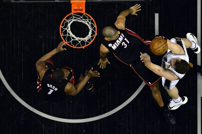 Jun 13, 2013; San Antonio, TX, USA; Miami Heat small forward Shane Battier (31) falls as San Antonio Spurs center Tiago Splitter (22) drives to the basket during game four in the 2013 NBA Finals at the AT&T Center. Mandatory Credit: Larry W. Smith/Pool Photo-USA TODAY Sports