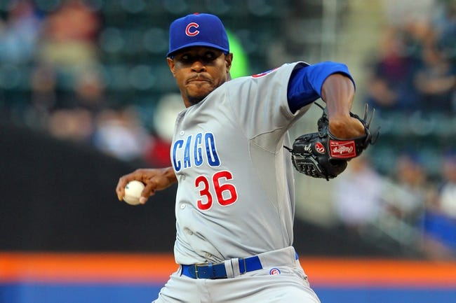 Jun 14, 2013; New York, NY, USA; Chicago Cubs starting pitcher Edwin Jackson (36) pitches against the New York Mets during the first inning of a game at Citi Field. Mandatory Credit: Brad Penner-USA TODAY Sports
