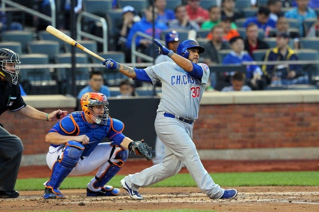 Jun 14, 2013; New York, NY, USA; Chicago Cubs catcher Dioner Navarro (30) hits a single against the New York Mets during the second inning of a game at Citi Field. Mandatory Credit: Brad Penner-USA TODAY Sports