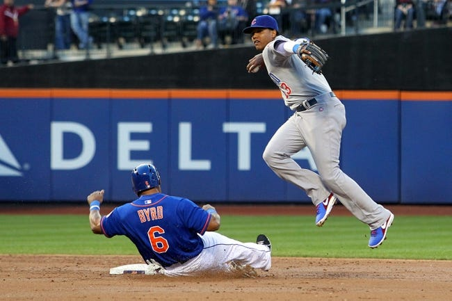 Jun 14, 2013; New York, NY, USA; Chicago Cubs shortstop Starlin Castro (13) turns a double play on New York Mets right fielder Marlon Byrd (6) on a ball hit by New York Mets catcher John Buck (not pictured) during the second inning of a game at Citi Field. Mandatory Credit: Brad Penner-USA TODAY Sports