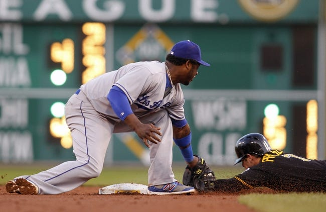 Jun 14, 2013; Pittsburgh, PA, USA; Los Angeles Dodgers shortstop Hanley Ramirez (left) tags out Pittsburgh Pirates left fielder Alex Presley (7) on a caught stealing during the fourth inning against at PNC Park. Mandatory Credit: Charles LeClaire-USA TODAY Sports