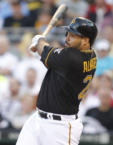 Jun 14, 2013; Pittsburgh, PA, USA; Pittsburgh Pirates third baseman Pedro Alvarez (24) hits a ground rule double against the Los Angeles Dodgers during the third inning at PNC Park. The Pittsburgh Pirates won 3-0. Mandatory Credit: Charles LeClaire-USA TODAY Sports