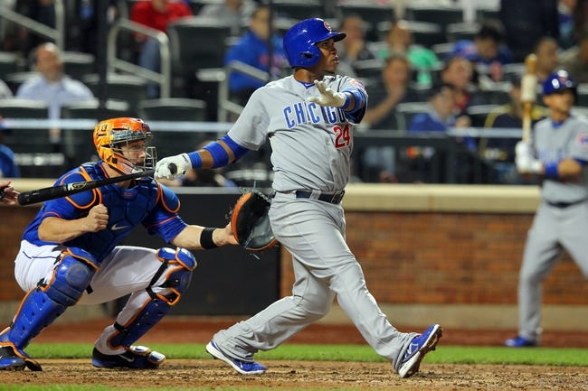 Jun 14, 2013; New York, NY, USA; Chicago Cubs third baseman Luis Valbuena (24) hit an RBI double against the New York Mets during the sixth inning of a game at Citi Field. Mandatory Credit: Brad Penner-USA TODAY Sports