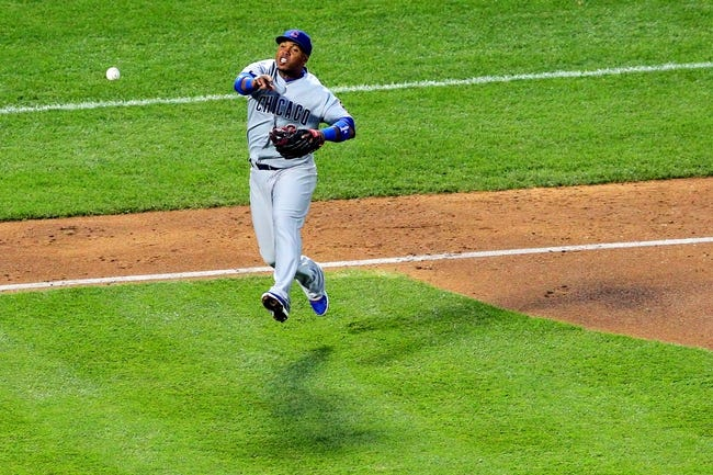 Jun 14, 2013; New York, NY, USA; Chicago Cubs third baseman Luis Valbuena (24) throws to first too late to get New York Mets right fielder Marlon Byrd (not pictured) during the fourth inning of a game at Citi Field. Mandatory Credit: Brad Penner-USA TODAY Sports