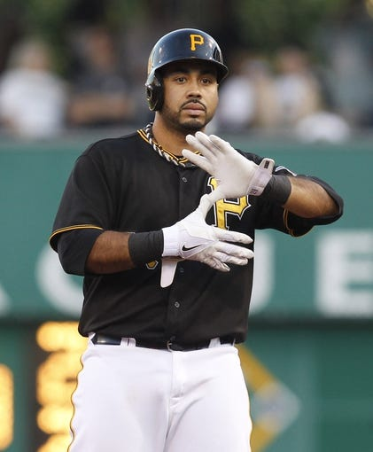 Jun 14, 2013; Pittsburgh, PA, USA; Pittsburgh Pirates third baseman Pedro Alvarez (24) reacts after hitting a double against the Los Angeles Dodgers during the third inning at PNC Park. The Pittsburgh Pirates won 3-0. Mandatory Credit: Charles LeClaire-USA TODAY Sports