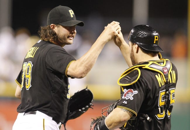 Jun 14, 2013; Pittsburgh, PA, USA; Pittsburgh Pirates relief pitcher Jason Grilli (left) and catcher Russell Martin (55) react after the final out against the Los Angeles Dodgers during the ninth inning at PNC Park. The Pittsburgh Pirates won 3-0. Mandatory Credit: Charles LeClaire-USA TODAY Sports