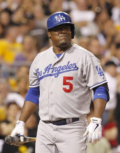 Jun 14, 2013; Pittsburgh, PA, USA; Los Angeles Dodgers third baseman Juan Uribe (5) reacts after striking out with two men on  against the Pittsburgh Pirates during the eighth inning at PNC Park. The Pittsburgh Pirates won 3-0. Mandatory Credit: Charles LeClaire-USA TODAY Sports