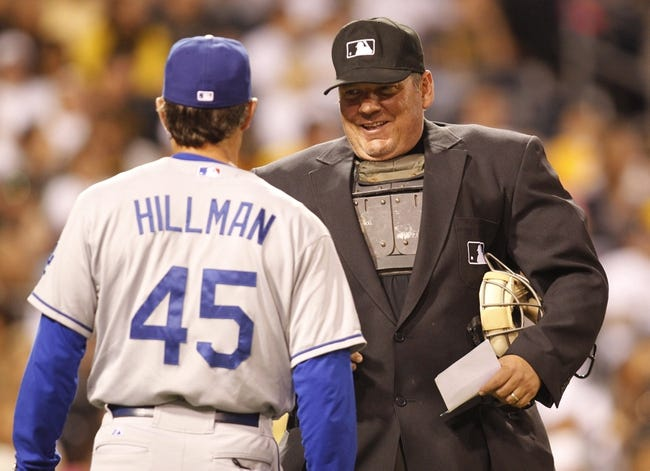 Jun 14, 2013; Pittsburgh, PA, USA; Los Angeles Dodgers acting manager Trey Hillman (45) talks to home plate umpire Hunter Wendelstedt (right) against the Pittsburgh Pirates during the eighth inning at PNC Park. The Pittsburgh Pirates won 3-0.  Mandatory Credit: Charles LeClaire-USA TODAY Sports