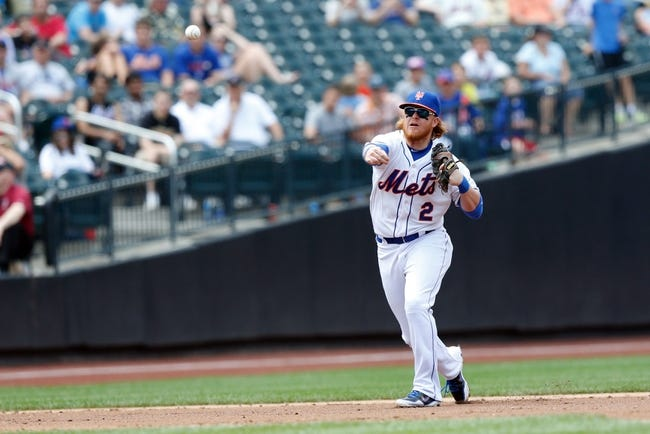Jun 15, 2013; Flushing, NY,USA;  New York Mets infielder Justin Turner (2)  throws to first for an out during the third inning against the Chicago Cubs at Citi Field.  Mandatory Credit: Anthony Gruppuso-USA TODAY Sports