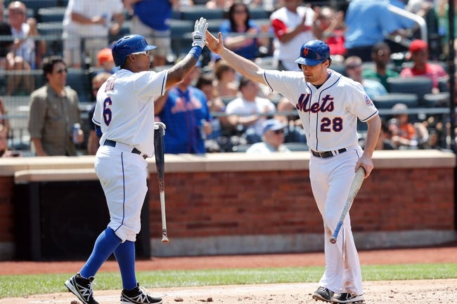 Jun 15, 2013; Flushing, NY,USA;  New York Mets right fielder Marlon Byrd (6) high fives second baseman Daniel Murphy (28) for scoring during the fourth inning against the Chicago Cubs at Citi Field.  Mandatory Credit: Anthony Gruppuso-USA TODAY Sports