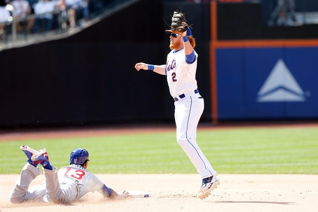 Jun 15, 2013; Flushing, NY,USA;  Chicago Cubs shortstop Starlin Castro (13) steals second base as New York Mets second baseman Justin Turner (2) is late with the tag during the seventh inning at Citi Field.  Mandatory Credit: Anthony Gruppuso-USA TODAY Sports