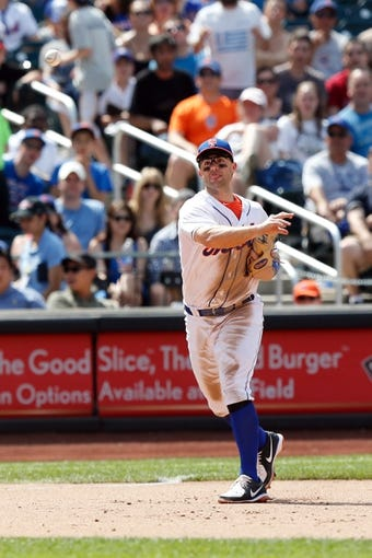 Jun 15, 2013; Flushing, NY,USA;  New York Mets third baseman David Wright (5) throws to first during the seventh inning against the Chicago Cubs at Citi Field.  Mandatory Credit: Anthony Gruppuso-USA TODAY Sports