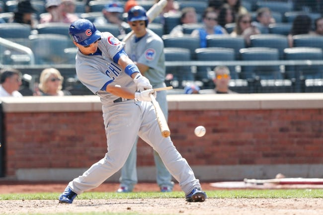 Jun 15, 2013; Flushing, NY,USA;  Chicago Cubs second baseman Darwin Barney (15) breaks his bat on a single to center during the eighth inning against the New York Mets at Citi Field.  The Cubs won 5-2.  Mandatory Credit: Anthony Gruppuso-USA TODAY Sports