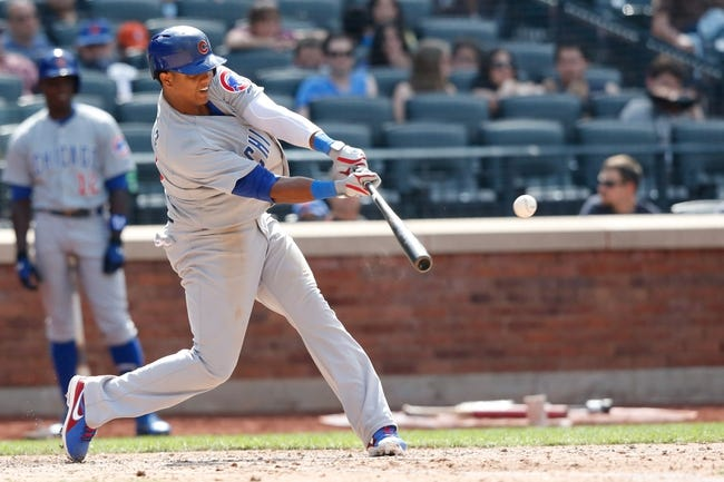Jun 15, 2013; Flushing, NY,USA;  Chicago Cubs shortstop Starlin Castro (13) hits a ground-rule double to deep left allowing two runners to score during the eighth inning against the New York Mets at Citi Field.  The Cubs won 5-2.  Mandatory Credit: Anthony Gruppuso-USA TODAY Sports