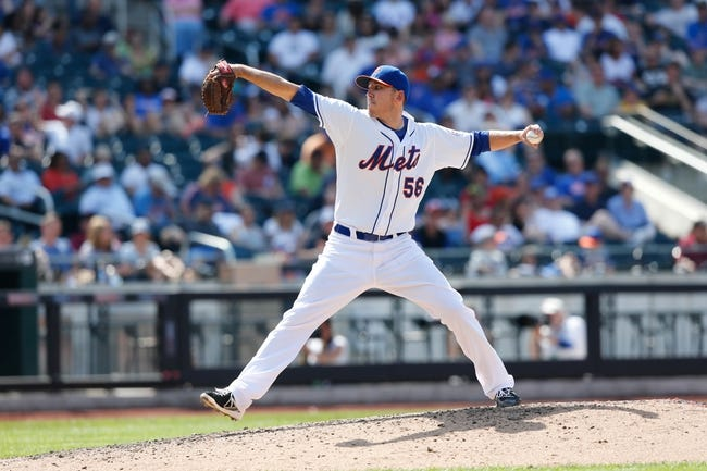 Jun 15, 2013; Flushing, NY,USA;   New York Mets relief pitcher Scott Rice (56) delivers a pitch during the eighth inning against the Chicago Cubs at Citi Field.  The Cubs won 5-2.  Mandatory Credit: Anthony Gruppuso-USA TODAY Sports