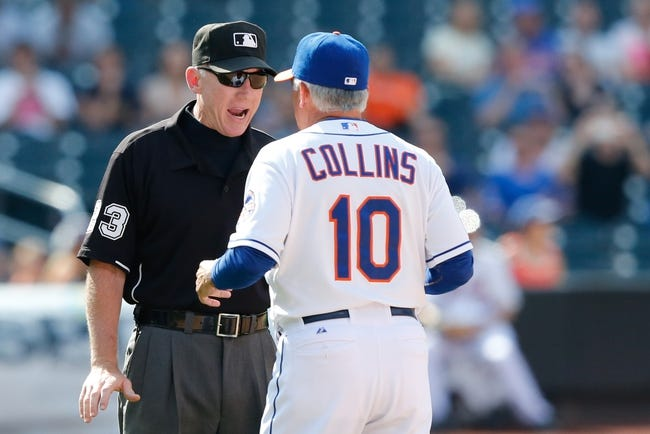Jun 15, 2013; Flushing, NY,USA;   New York Mets manager Terry Collins (10) argues a call with umpire Lance Barksdale (23) during the ninth inning against the Chicago Cubs at Citi Field.  The Cubs won 5-2.  Mandatory Credit: Anthony Gruppuso-USA TODAY Sports
