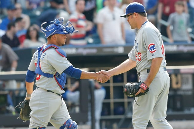 Jun 15, 2013; Flushing, NY,USA;  Chicago Cubs relief pitcher Kevin Gregg (63) and catcher Welington Castillo (53) celebrate the win against the New York Mets  at Citi Field.  The Cubs won 5-2.  Mandatory Credit: Anthony Gruppuso-USA TODAY Sports
