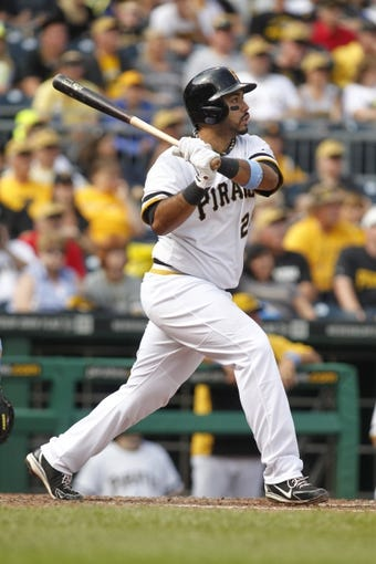 Jun 16, 2013; Pittsburgh, PA, USA; Pittsburgh Pirates third baseman Pedro Alvarez (24) watches his three run home run clear the fence against the Los Angeles Dodgers during the fifth inning at PNC Park. The Pittsburgh Pirates won 6-3. Mandatory Credit: Charles LeClaire-USA TODAY Sports