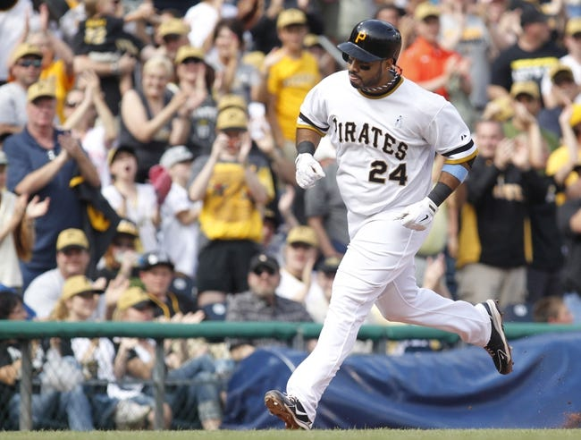 Jun 16, 2013; Pittsburgh, PA, USA; Pittsburgh Pirates third baseman Pedro Alvarez (24) rounds the bases after hitting a three run home run against the Los Angeles Dodgers during the fifth inning at PNC Park. The Pittsburgh Pirates won 6-3. Mandatory Credit: Charles LeClaire-USA TODAY Sports