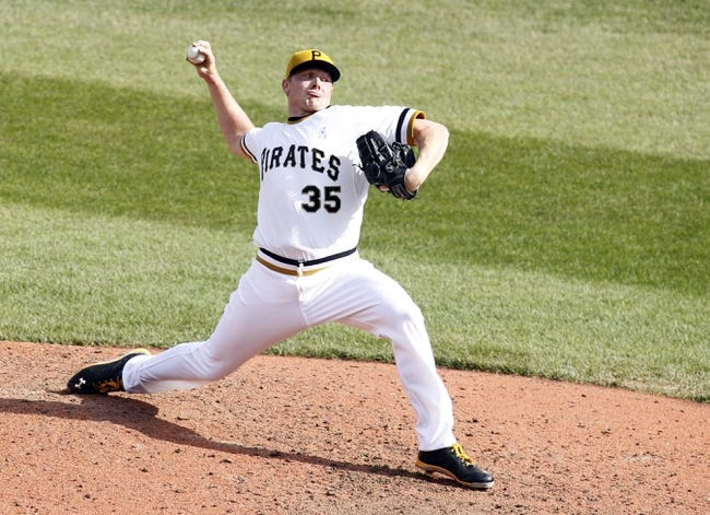 Jun 16, 2013; Pittsburgh, PA, USA; Pittsburgh Pirates relief pitcher Mark Melancon (35) pitches against the Los Angeles Dodgers during the eighth inning at PNC Park. The Pittsburgh Pirates won 6-3. Mandatory Credit: Charles LeClaire-USA TODAY Sports
