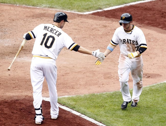 Jun 16, 2013; Pittsburgh, PA, USA; Pittsburgh Pirates left fielder Alex Presley (7) is greeted by shortstop Jordy Mercer (10) after Presley hit a solo home run against the Los Angeles Dodgers during the sixth inning at PNC Park. The Pittsburgh Pirates won 6-3. Mandatory Credit: Charles LeClaire-USA TODAY Sports