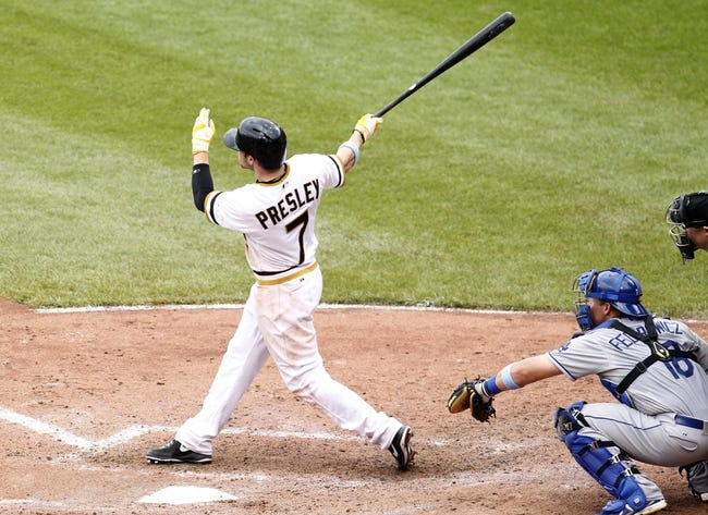 Jun 16, 2013; Pittsburgh, PA, USA; Pittsburgh Pirates left fielder Alex Presley (7) hits a solo home run against the Los Angeles Dodgers during the sixth inning at PNC Park. The Pittsburgh Pirates won 6-3. Mandatory Credit: Charles LeClaire-USA TODAY Sports