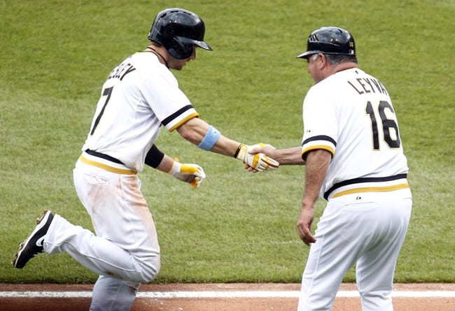 Jun 16, 2013; Pittsburgh, PA, USA; Pittsburgh Pirates left fielder Alex Presley (7) is greeted by third base coach Nick Leyva (16) after Presley hit a solo home run against the Los Angeles Dodgers during the sixth inning at PNC Park. The Pittsburgh Pirates won 6-3. Mandatory Credit: Charles LeClaire-USA TODAY Sports